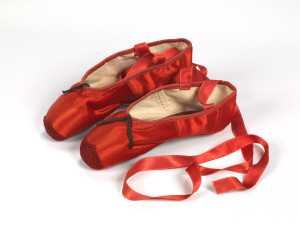 4._Freed_of_London_founded_in_1929_red_ballet_shoes_made_for_Victoria_Page_Moira_Shearer_in_The_Red_Shoes_1948_silk_satin_braid_and_leather_England_1948_Northampton_Museums_and_Art_Gallery